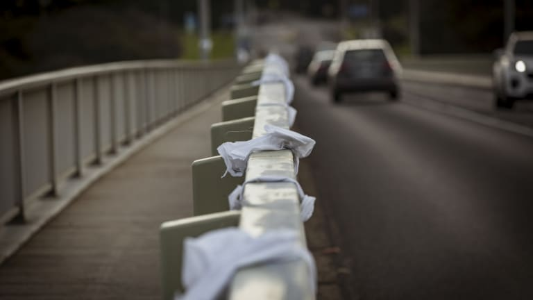 White bows in memory of Samantha Fraser adorn the bridge connecting Phillip Island to the mainland