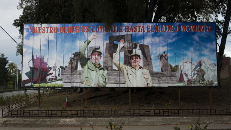 "A billboard featuring Fidel and Raul Castro, reading ""Our duty is to fight until the last moment,"" in Holquin, Cuba, in  2014."