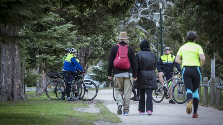 Police on pushbikes patrolled the park as it reopened to the public on Wednesday afternoon.