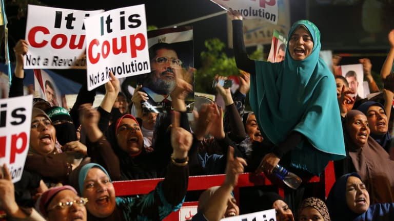 Muslim brotherhood supporters of ousted president Mohamed Morsi attend a protest near Rabaa al-Adawiya mosque in Cairo, Egypt, in 2013.