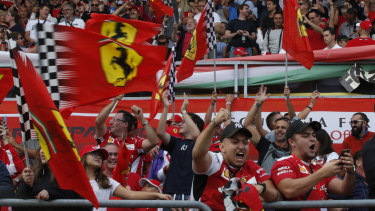 Rejoice: Ferrari fans celebrate their one-two finish in qualifying.