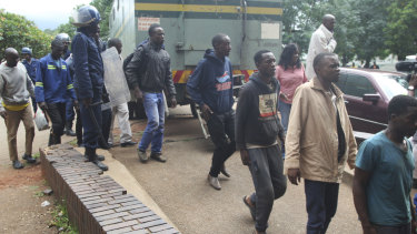 Dozens of protesters arrive at court in Harare on Wednesday.