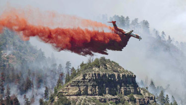 An aircraft drops fire retardant on the fire in the mountains near Durango, Colorado. Fires in the south-west of the state continue to burn largely out of control.