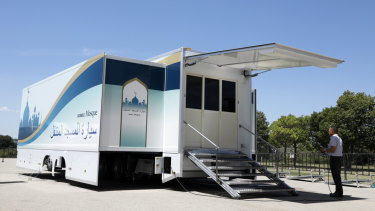 A staff member operates Mobile Mosque during an unveiling event  in Toyota, western Japan.