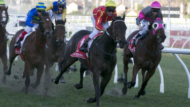 Voodoo Lad moves into a winning position in the Ladbrokes Sir John Monash Stakes.