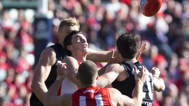 On point: Tom McCartin of the Swans takes a mark against the Blues.