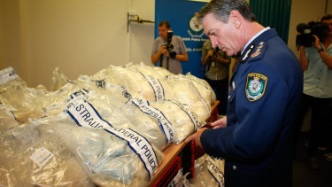 Then NSW Police Commissioner Andrew Scipione inspects the drug haul at the centre of the trial.