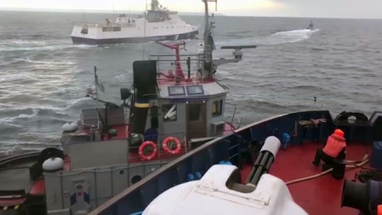 A video screenshot taken from a Russian Coast Guard vessel purports to show the Russian coast guard and a Ukrainian tugboat collide in the Kerch Strait on Sunday.