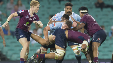 Crunch time: Lukhan Salakaia-Loto runs into some stern Waratahs defence.