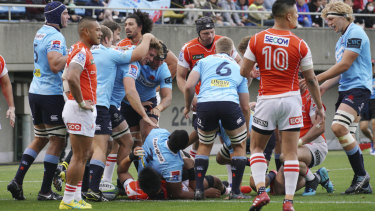 Try blitz: The Waratahs celebrate after another try in a high-scoring affair at Chichibunomiya Rugby Stadium.