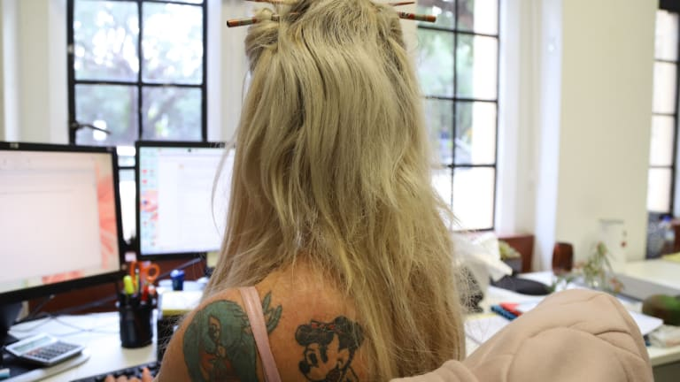 Tattoos are becoming more acceptable in the workplace, new research suggests.