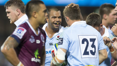 Rivalry: Kurtley Beale congratulates Alex Newsome on scoring a try against Queensland in round four.