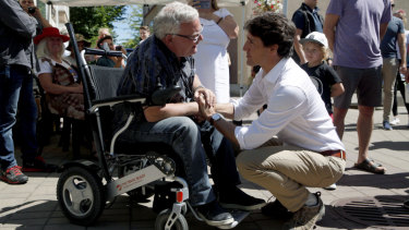 Justin Trudeau, right, meets with Duncan Mayor Phil Kent as he visits locals at the Duncan Farmers Market in Duncan, British Columbia.