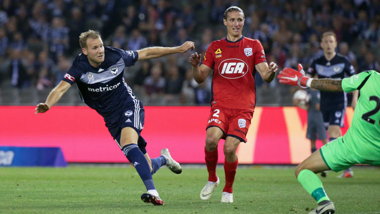 Ola Toivonen of the Victory puts the ball past Adelaide United goalkeeper Paul Izzo.