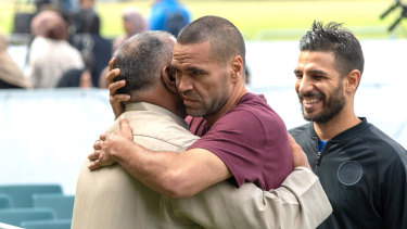 Australian boxer Anthony Mundine, in red, joins Muslims for the call to pray at Hagley Park, opposite the Al Noor mosque, in Christchurch, New Zealand, on Friday.