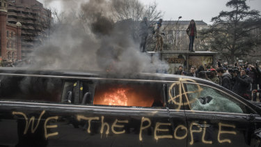 Protesters burn a limousine during the January 20 demonstrations against the inauguration of US President Donald Trump.