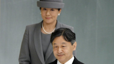 Japanese Emperor Naruhito, accompanied by Empress Masako, walks to deliver his remarks during a memorial ceremony for the war dead at Nippon Budokan Martial Arts Hall in Tokyo.