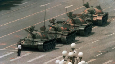 'Tank Man' stands in front of a line of tanks in Tiananmen Square on June 5, 1989.