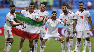 All smiles: Iran's players celebrate their victory.