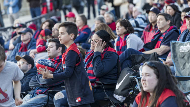 Melbourne supporters at Federation Square grew more subdued as the Eagles' lead grew.
