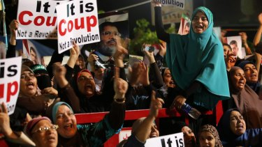 Supporters of ousted Egyptian president Mohamed Morsi protest in Cairo in 2013. Facebook's rules have tended to favour state power in the Middle East, especially against religiously-based opposition.