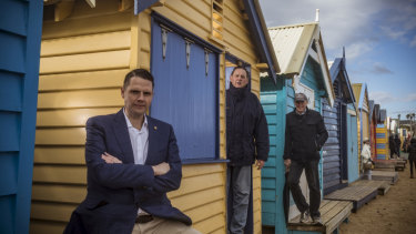 Brighton MP James Newbury with members of the Brighton Bathing Box Association, Bill Mears and Geoff Cunningham at Bill's beach box in Brighton.
