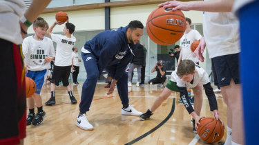 NBA star Ben Simmons practises with kids at his basketball camp in Donvale on Sunday.