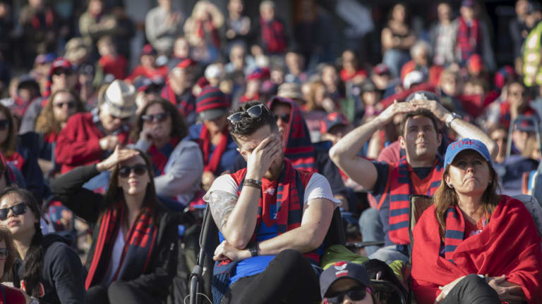 Melbourne fans at Federation Square show their emotions as West Coast streamed to an early lead.