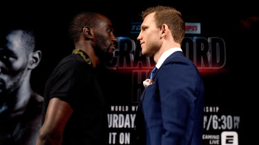 Close quarters: Terence Crawford and Jeff Horn face off at the weigh-in ahead of their fight at the MGM Grand.
