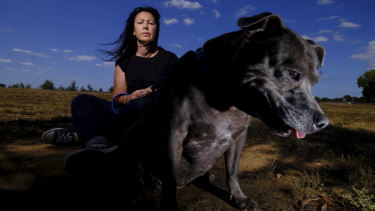 Lianne, seen here with her dog in Wyndham Vale, is taking Melbourne Uni to court over gender discrimination.
