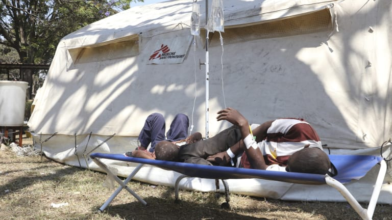 Patients rest at a field hospital in Harare. A cholera emergency has been declared in Zimbabwe's capital after 20 people died.