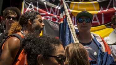 An Invasion Day protester shouts at a far-right nationalist  after he refused to move off the Flinders Street steps during the Invasion Day march.