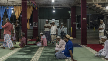 Men pray in the Badhiriy Yah Jumah Mosque. in Kattankudy, Sri Lanka.