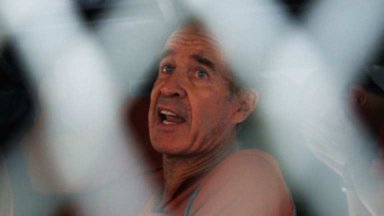 Australian filmmaker James Ricketson inside a prison van on his way to a hearing.