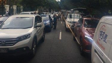 Motorists leave their cars on Alice Street.