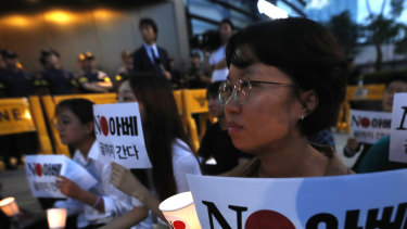 South Koreans protest the Japanese government's decision on their exports to South Korea in front of the Japanese embassy in Seoul.