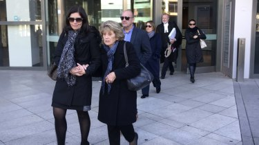 The family of Zacharias Andreou leaving Parramatta District Court.