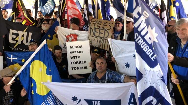 Unionists and striking Alcoa workers protesting outside parliament house in August.