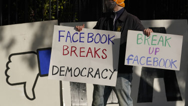 Backlash against Facebook: A demonstrator outside of the home of Facebook CEO Mark Zuckerberg in November.