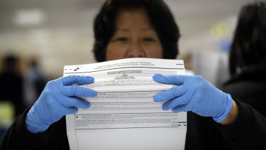 A mail-in ballot is examined at the Santa Clara County Registrar of Voters in San Jose, California.