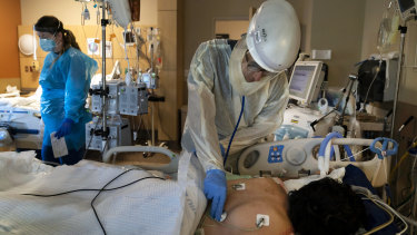 A doctor checks on a COVID-19 patient at a hospital in Los Angeles.