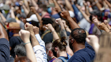 Demonstrators raise fists in the air during a march in Pittsburgh to protest the death of George Floyd.