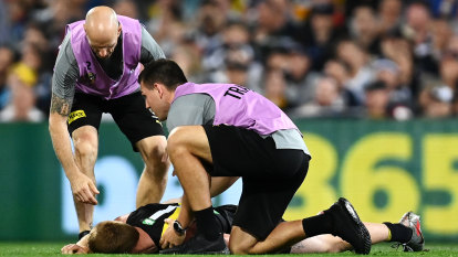 Coronial report shows AFL players are still hiding concussion