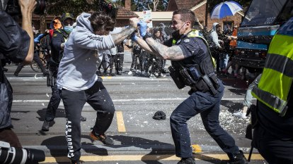Ten police injured, more than 200 arrested in anti-lockdown protest