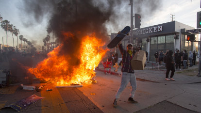 As riots spread, officials fear extremists are fanning the flames