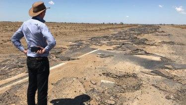 Main Roads Minister Mark Bailey inspects damageon the Flinders Highway, east of Julia Creek.