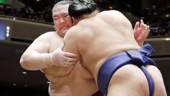 Retiring: Kisenosato Yutaka, left, was one of three men worldwide at the highest rank of sumo wrestling and the only Japanese.