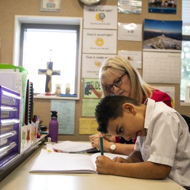 Elias Dahrie, 6, reads using a whole-language method with teacher Maree Grainger.