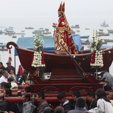 "A Peruvian fishing community carries its patron saint during a Catholic celebration. In the 1600s, fishermen in Peru coined the term El Nino (""little boy"" or Christ child"") to describe a weather event that left them low on seafood around Christmas time."