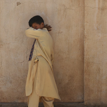 A boy walks along a wall at Zero Point.